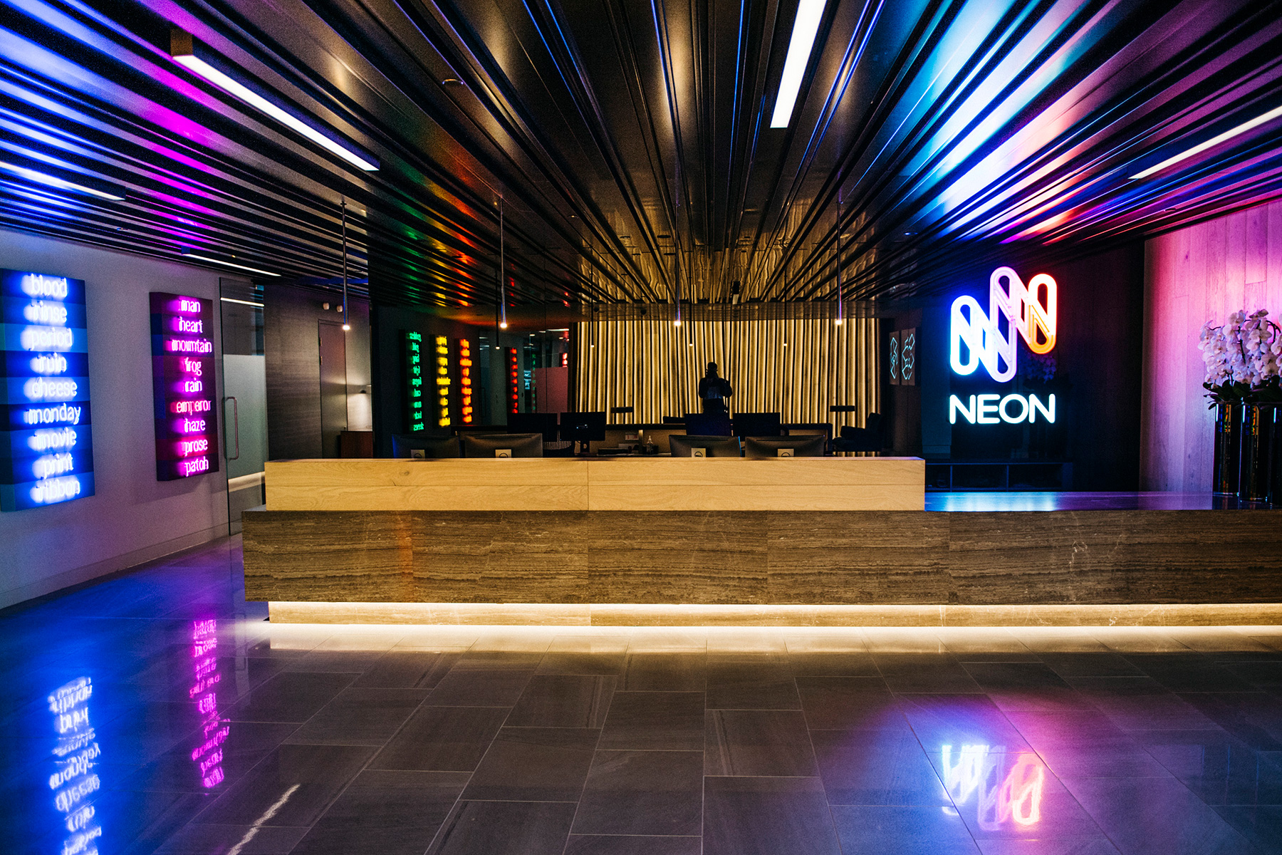 The combination of Neon branding and complimentary bright Neon artwork creates a bright and inspirational workplace.